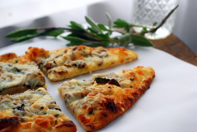 mushroom pizza with sage and curtain