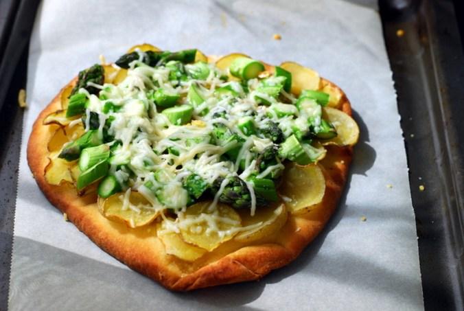 asparagus potato naan on baking sheet