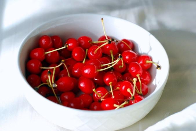 cherries in white bowl 3