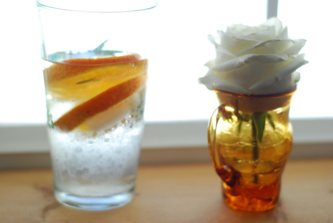 orange rosemary water at window