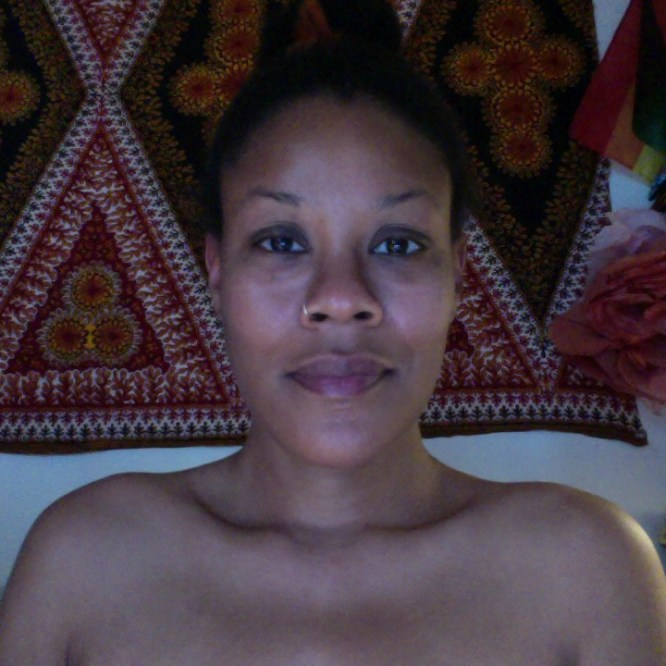 This is me in my living room with no make-up, no eyebrows, vulnerable and naked in my birthday suit.