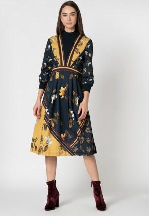 Rochie cu model floral si insertie din jerseu
