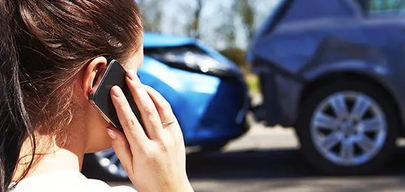 lady on phone auto accident chiropractic treatment el paso tx