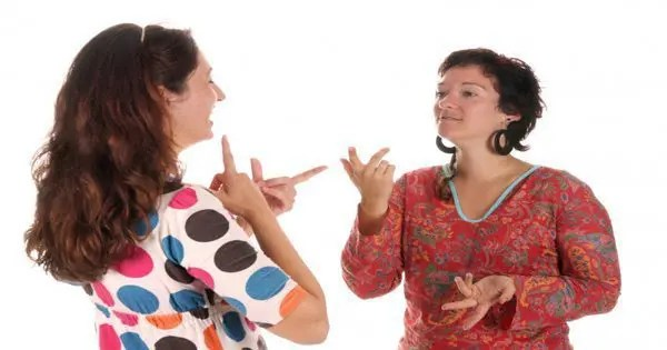 blog picture of two ladies having sign language conversation