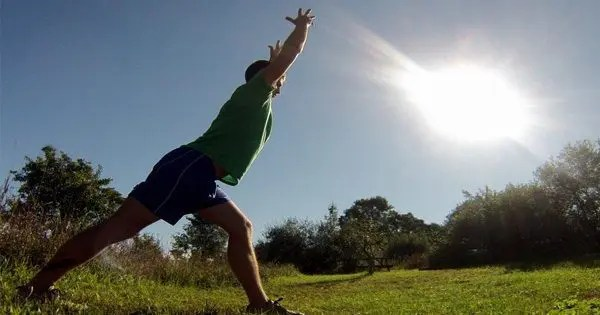 blog picture of a man stretching out in a field under the sun
