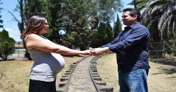 blog picture of couple on railroad tracks holding hands