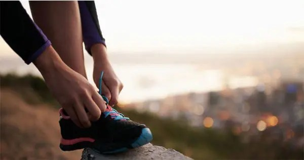 blog picture of woman tying her shoe getting ready to run