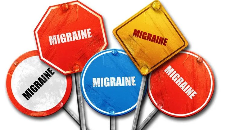 Street signs with migraine written