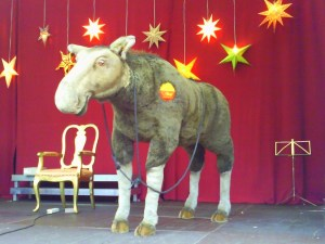 Stage Property moose with gold stars in the background on a stage.