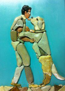 إنسان وكلب من الحجارة