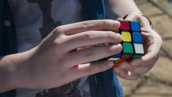 How can solving the Rubik's cube help grow your faith in God?