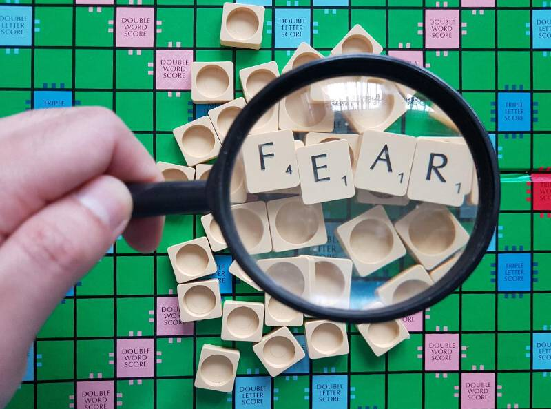 Fear - false evidence appearing real magnifying glass - Why Is It Important To Interpret Life Through God's Eyes?