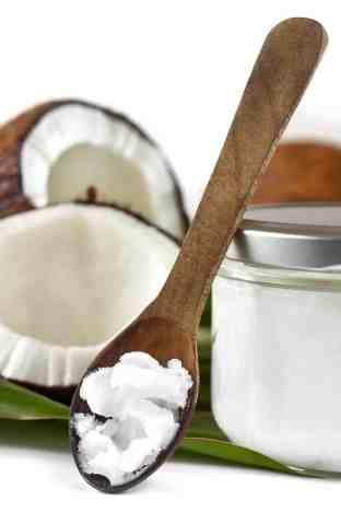 coconut oil on wooden spoon