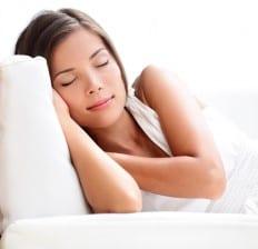 Sleeping woman on sofa
