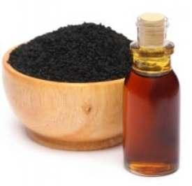 Cumin noir avec de l'huile essentielle, huile de graines noires