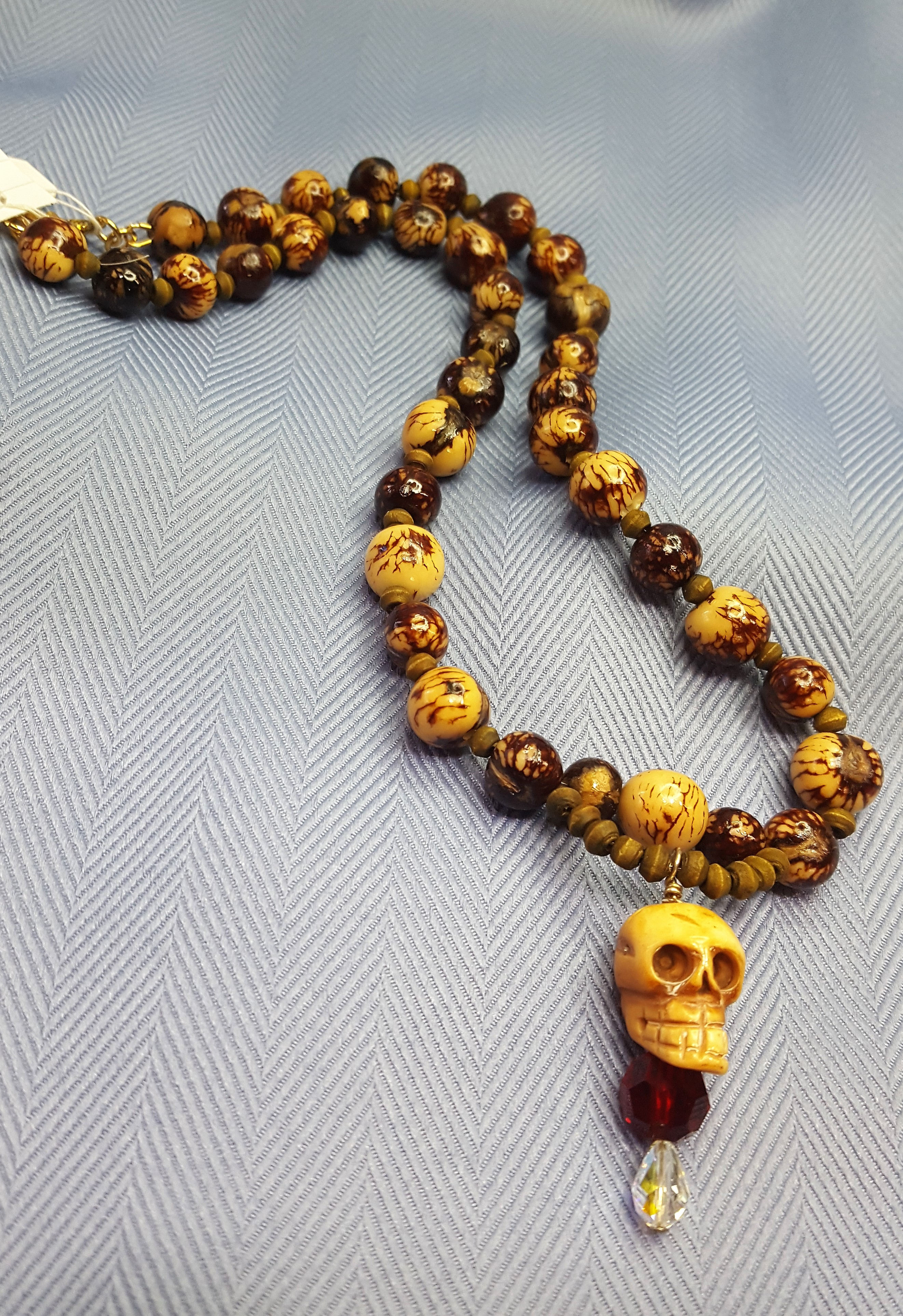 The Nutty Skull Hand Carved Bone Skull With Swarovski Crystals Acai Nuts And Beetle Nuts Drayton Jewelry