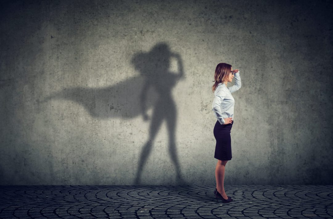 image of business woman with superhero shadow