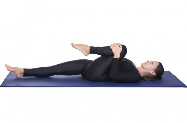 wind relieving pose for back pain in hindi