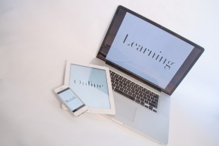 Phone, tablet and laptop computer with words mobile online learning