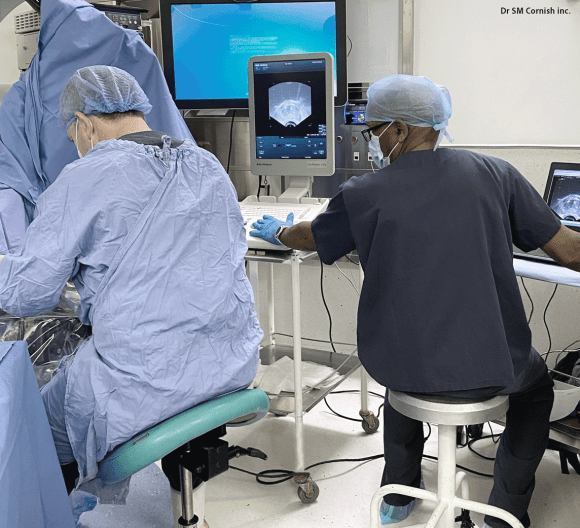 Image of a urologist and physicist during a brachytherapy procedure