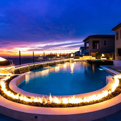 A breathtaking outdoor resort with a 30′ long custom fire feature!