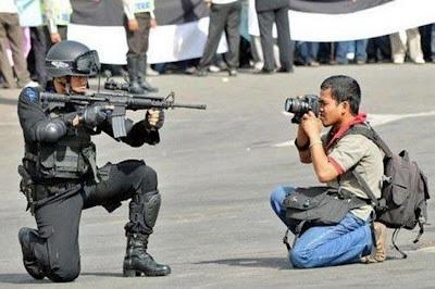 camera vs gun.jpg