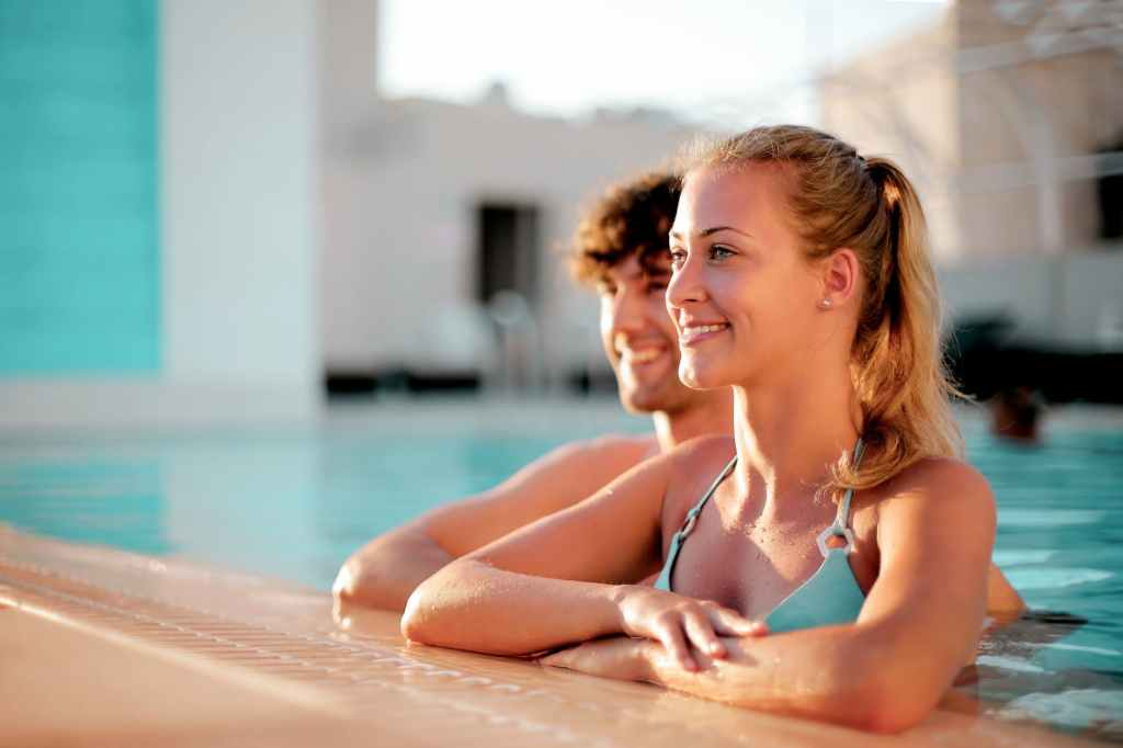 woman smiling while on swimming pool