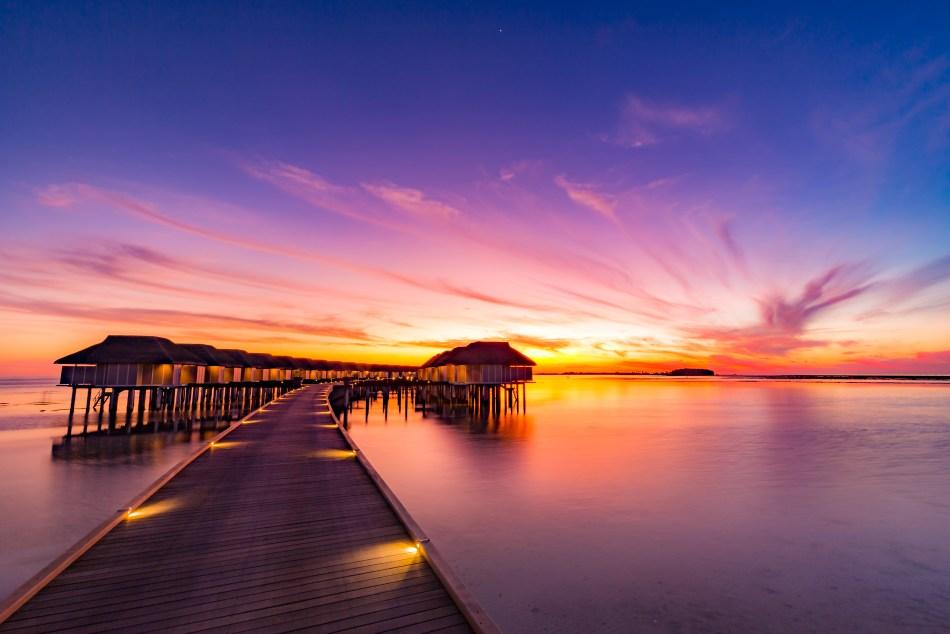 Maldives sunset overwater villas