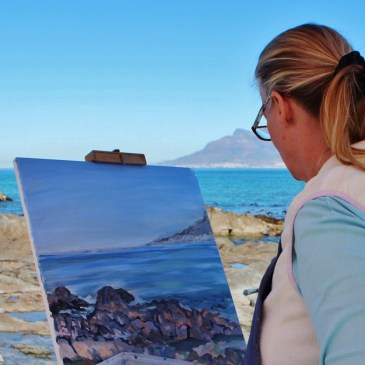 image of artist painting a landscape