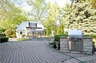 Amazing paved backyard with BBQ
