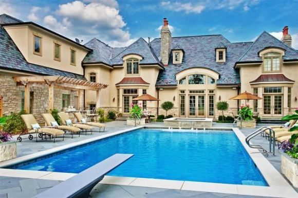 Pool and Spa with Fireplace and Outdoor Kitchen