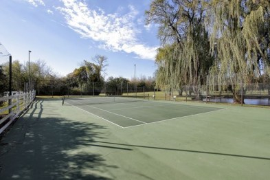 Tennis court surrounded by 25 acres of wooded land | Highland Park, IL | Listed by Julie Deutsch and Maureen Mohling