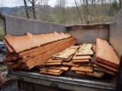 We cut our own larch into waney edged planks