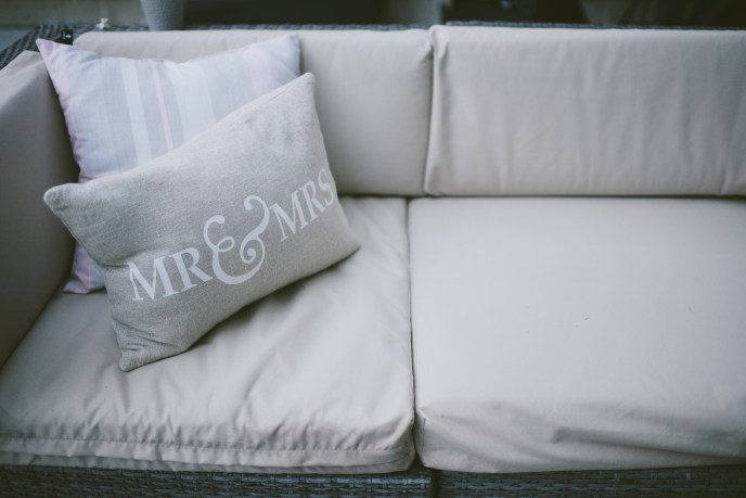 mr & mrs pillow on outdoor couch at a backyard wedding by a saugatuck wedding planner