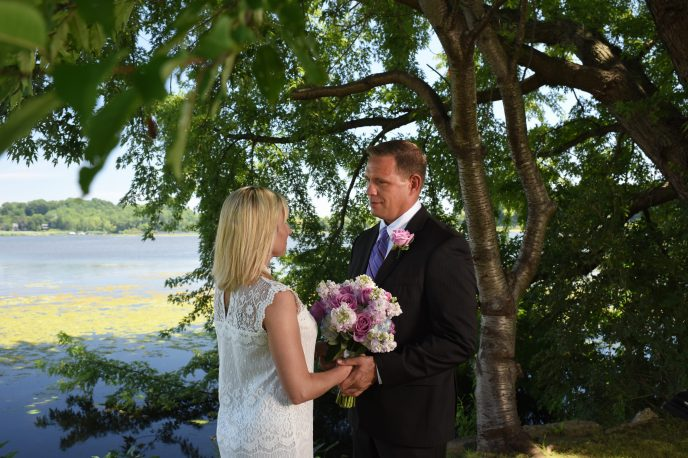 couple exchanging looks during elopement at wade's bayou