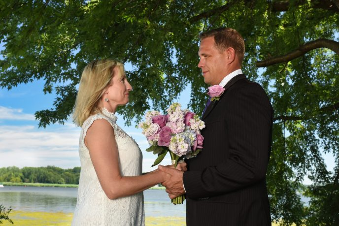 close up of couple during wedding with water in background at wade's bayou