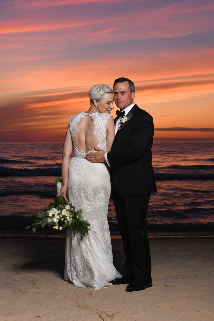 sumer elopement, elope in South Haven on the beach, bride and groom on beach at sunset
