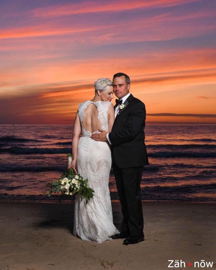 photography of bride and groom on beachw ith sunset