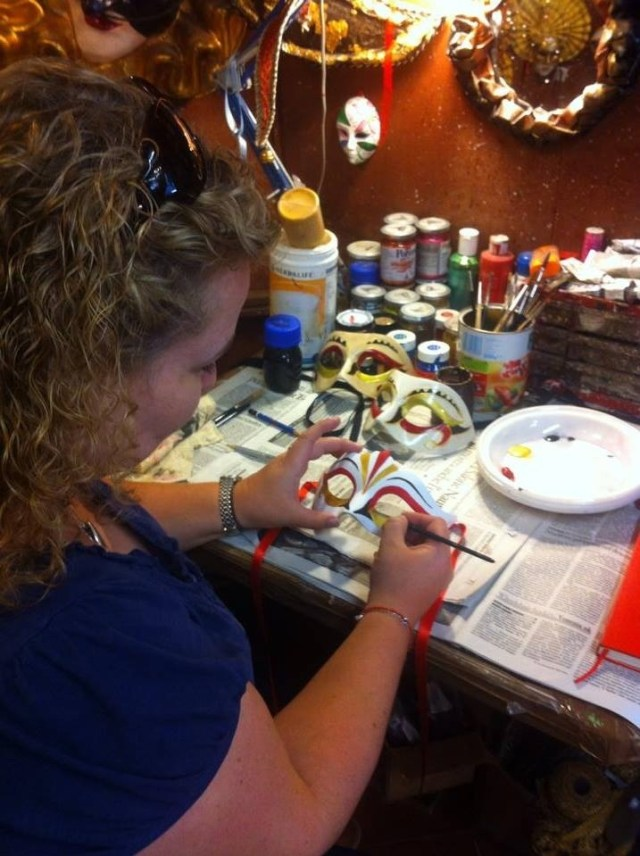 Hand painting a Venetian carnival mask needs a steady hand!