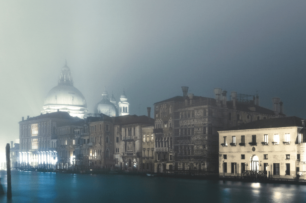 View of the Salute church's dome through the mist along the Grand Canal