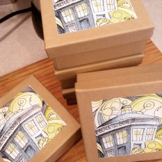 All the boxes with their artwork applied and ready for some finality.