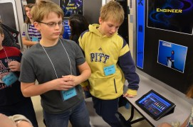 Students proudly share their expertise about the simulation stations.