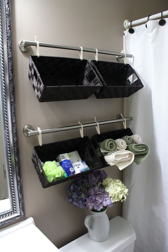 Trend DIY Bathroom Organization Ideas Create a Wall full of Basket Organizers over the Toilet for