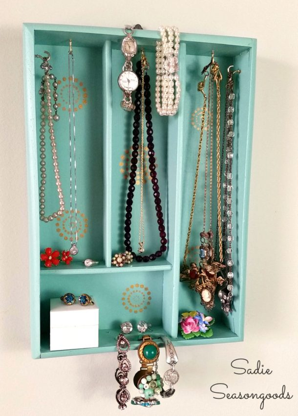 DIY Bathroom Organizer Ideas - Upcycle a silverware tray into a pretty hanging jewelry organizer - Tutorial via Sadie Seasongoods