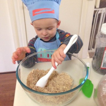 Son helping with mixing bowl