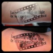 Svetlyo , Custom black and gray old movie tape tattoo