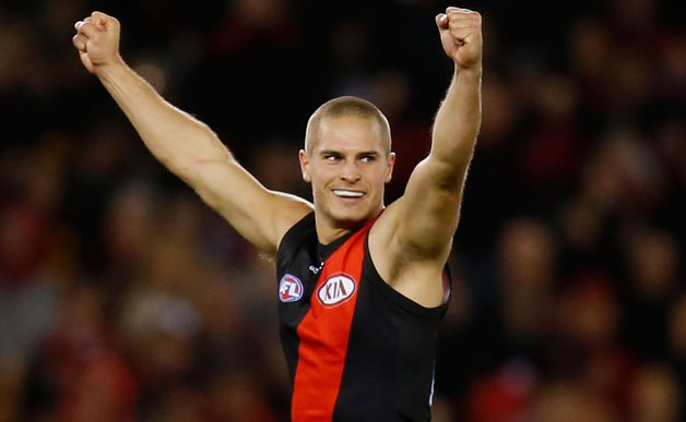 David Zaharakis of the Bombers celebrates a goal during the 2013 AFL Round 15 match between the Essendon Bombers and Port Adelaide Power at Etihad Stadium, Melbourne on July 07, 2013. (Photo: Lachlan Cunningham/AFL Media)