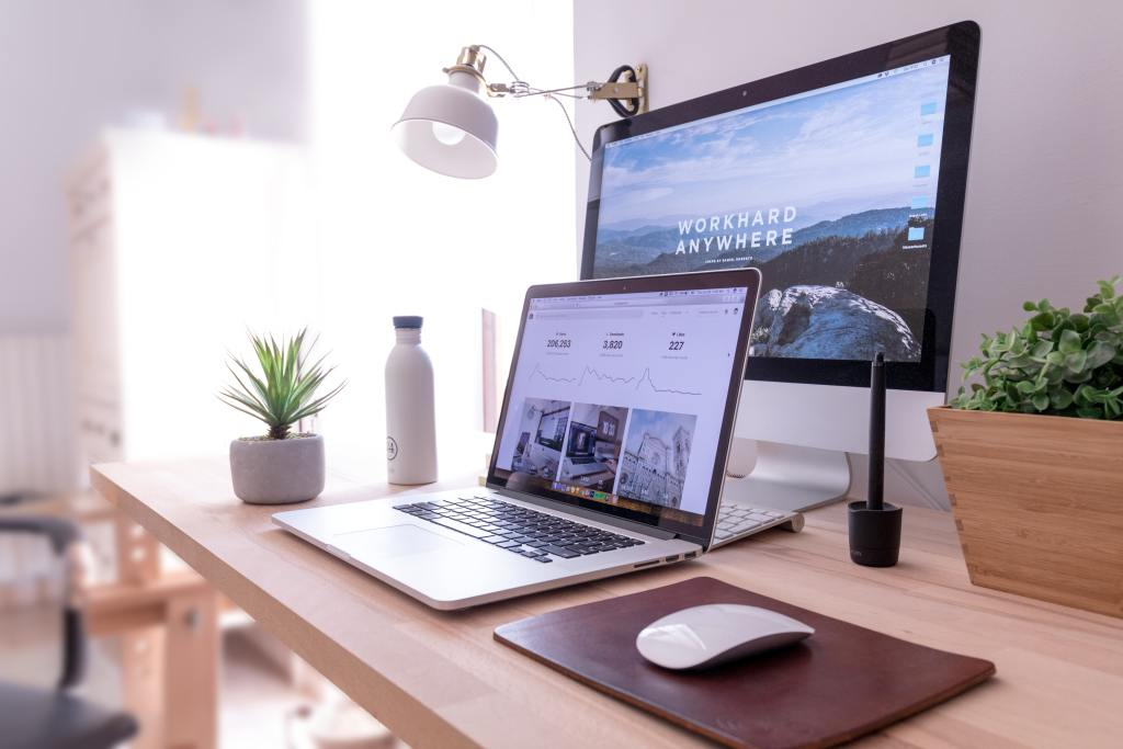 office desk with laptop and extra screen