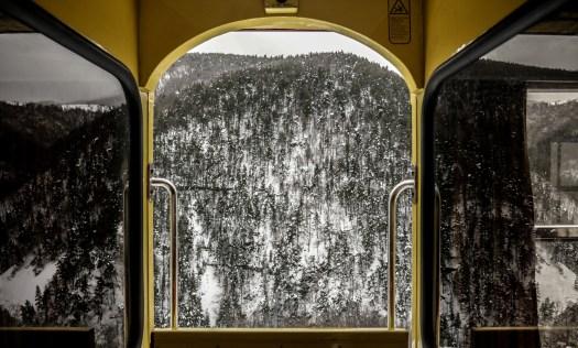 View from the yellow train, a french heritage, on a valley, beautiful landscape snow covered, pyrenees orientales, region of southwest of France. Vue depuis le train jaune, un patrimoine francais, sur une vallee, magnifique paysage enneige, pyrenees orientales, region du sud ouest de la France