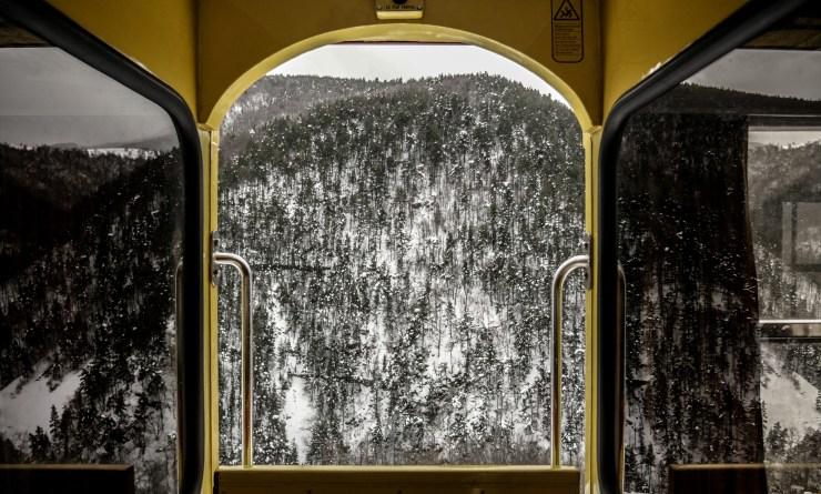 View from the yellow train, a french heritage, on a valley, beautiful landscape snow covered, pyrenees orientales, region of southwest of France.Vue depuis le train jaune, un patrimoine francais, sur une vallee, magnifique paysage enneige, pyrenees orientales, region du sud ouest de la France